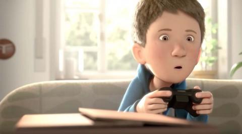 un niño mira absorto la tele mientras juega a un videojuego en the present